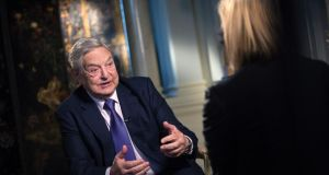 George Soros, billionaire and founder of Soros Fund Management LLC, left, speaks during a Bloomberg Television interview in London. Photograph: Simon Dawson/Bloomberg