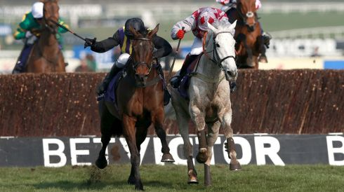 Over the last, eventual winer O'Faolains Boy,  ridden by Barry Geraghty, battled it out with  Smad Place, ridden by Robert Thornton. Photograph:  David Davies/PA Wire