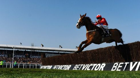 Favourite Sire De Grugy, with Jamie Moore in the saddle, clear the last to win the Queen Mother Champion Chase. Photograph:  Alan Crowhurst/Getty Images