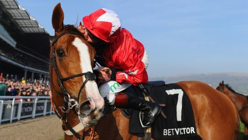 Jamie Moore and Sire de Grugy celebrate victory in the Queen Mother Champion Chase. Photograph: Mike Hewitt/Getty Images