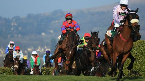 The Glenfarclas Handicap Steeple Chase field, including eventual winner Richard Johnson on Balthazar King (red & blue), negotiates Cheltenham's ups and downs.  Photograph: Richard Heathcote/Getty Images