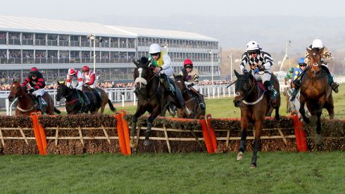 In the Fred Winter Juvenile Handicap Hurdle, Brian Hughes guided Hawk High (green and yellow) to victory.  Photograph: Inpho/Dan Sheridan