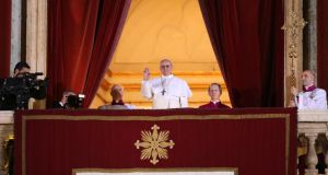 Newly elected Pope Francis I waves to the waiting crowd from the central balcony of St Peter's Basilica on March 13th, 2013. Photograph: Getty