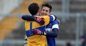 Hugh Gill (right) celebrates St Vincent's Leinster club final victory over Portlaoise with goalkeeper Michael Savage. Photograph: Donall Farmer/Inpho