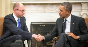 President Barack Obama greets Arseniy Yatsenyuk, Ukraine's interim prime minister, during a meeting in the Oval Office yesterday. Photograph: Gabriella Demczuk/The New York Times