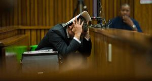 South African Paralympic athlete Oscar Pistorius reacts in the dock while hearing graphic details  during his murder trial at the North Gauteng High Court in Pretoria, South Africa, today. Photograph: Alet Pretorius/EPA