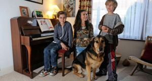 Adrienne Murphy, with her children, Fiach (left) and Caoimh Connolly, with Cosmo the dog. Photograph: Dave Meehan