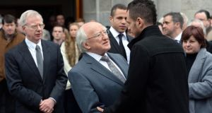 President Michael D.Higgins offers his condolences to Darragh Buckley son of campaigner Christine Buckley during her funeral at St.Therese Church Mount Merrion Dublin, also in the photograph is husband Donal (left) and son Conor. Photograph: Brenda Fitzsimons/The Irish Times
