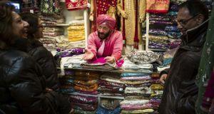 Jationder Pal Singh selling fabrics at his shop in the Little India neighborhood of Toronto