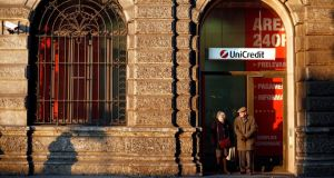 UniCredit branch in Milan: the bank stunned investors with a large annual loss on Tuesday in a massive clean out of its balance sheet. photograph: alessia pierdomenico/bloomberg