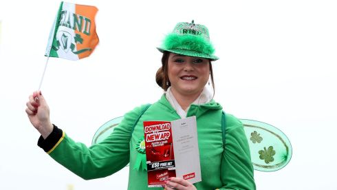 And Westmeath calling ... Margaret Connolly from Mullingar wears the green at Prestbury Park. Photograph: Inpho/Dan Sheridan