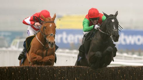 Taquin Du Seuil  and Tony McCoy (right) jump the last on the way to win the JLT Novices' Chase.  The 7/1 shot was McCoy's first win of this year's festival. Photograph: Joe Giddens/PA