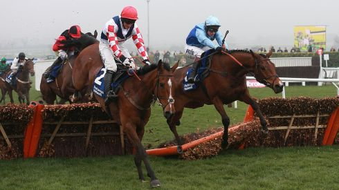 Richard Johnson and Fingal Bay crashed through this hurdle before winning the Pertemps Network Final ahead of Southfield Theatre, ridden by Daryl Jacob. Photograph:  David Davies/PA