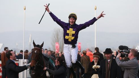 Robbie McNamara jumps off Spring Heeled as he celebrates winning the Fulke Walwyn Kim Muir Challenge Cup Handicap Chase. Photograph:  David Davies/PA