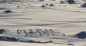 Readership patterns: irishtimes.com imprinted on the Arctic snow by Charlie Bird