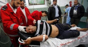 Palestinian medics tend to a man whom they said was wounded in an Israeli air strike, at a hospital in Rafah in the southern Gaza Strip on March 13th, 2014. Photograph: Ibraheem Abu Mustafa/Reuters