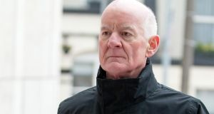 Former financial regulator Patrick Neary arriving at Dublin Circuit Criminal Court yesterday to give evidence during the trial of three former directors of Anglo Irish Bank. Photograph: Collins