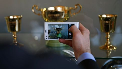 This is what it's all about... A racegoer takes a picture of the Cheltenham Gold Cup. Photograph: Eddie Keogh/Reuter