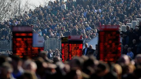 Racegoers watch from the open stand in the Desert Orchid enclosure. Photograph: Alan Crowhurst/Getty Images