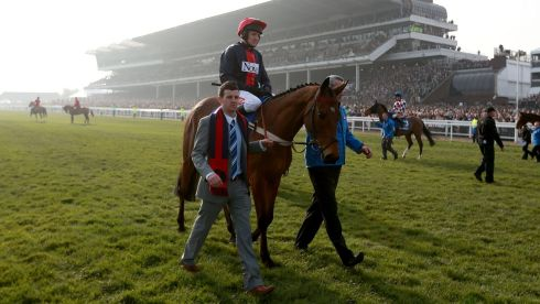 Defending champion Bobs Worth, ridden by jockey Barry Geraghty, going to post prior to the Gold Cup. Photograph: David Davies/PA Wire