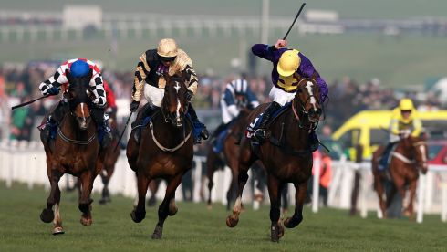 Lord Windamere ridden by jockey Davy Russell (right) battles with On His Own in the closing stages of the Cheltenham Gold Cup. Photograph: David Davies/PA Wire