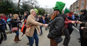 Merle Bukowski and Julian Middeke from Lower Saxony, Germany, enjoying the St Patrick's Festival Céilí Mór at   St  Stephen's Green Dublin.  Photograph: Alan Betson/ The Irish Times