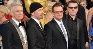 U2's Larry Mullen Jr, The Edge, Bono and Adam Clayton  attend the Oscars earlier in the month