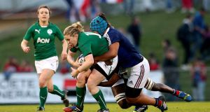 Ireland's Niamh Briggs is tackled by  Coumba Diallo and Safi N'Diaye of France in Pau.  Photograph: James Crombie/Inpho