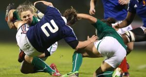 Ireland's Niamh Briggs and Larissa Muldoon tackle Gaelle Mignot of France in Pau. Photograph: James Crombie/Inpho