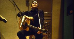 Country/Western singer Johnny Cash in recording studio. (Photo by Michael Rougier//Time Life Pictures/Getty Images)
