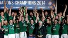 Ireland's players celebrate winning  the  Six Nations at  Stade de France.  Photograph: Gonzalo Fuentes/Reuters