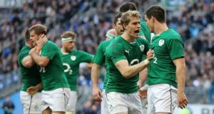 Ireland's Jonathan Sexton celebrates scoring the opening try with Andrew Trimble. Photograph: James Crombie/Inpho