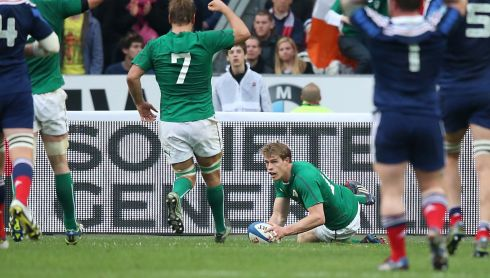 Ireland's Andrew Trimble goes over for their second try as Chris Henry celebrates. Photograph: Billy Stickland/Inpho