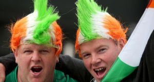 Irish fans Michael Coyne and Oliver Broderick from Co Waterford celebrate victory in Paris. Photograph: Dan Sheridan/Inpho