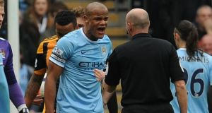 Manchester City's Vincent Kompany argues with referee Lee Mason after being sent off during  at the KC Stadium. Photograph: Anna Gowthorpe/PA Wire