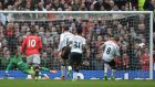 Liverpool's Steven Gerrard (right) scores the opening goal at  Old Trafford. Photograph:  Photograph: Peter Powell/EPA