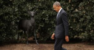 US President Barack Obama walks across the South Lawn of the White House. Photograph: Chip Somodevilla/Getty