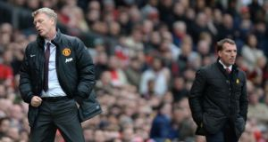 Manchester United manager David Moyes (left) and Liverpool's manager Brendan Rodgers on the touchline  at Old Trafford. Photograph: Peter Powell/EPA