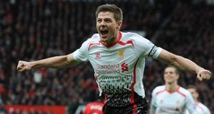 Liverpool's Steven Gerrard celebrates scoring Liverpool's second goal  at Old Trafford. Photograph: Peter Powell/EPA
