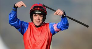 Ruby Walsh, who is recovering from surgery on a broken arm on Friday following a fall in at the Cheltenham Festival, has begun receiving messages of support on Twitter after receiving death threats. Photograph:  Mike Hewitt/Getty Images