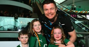 Brian O'Driscoll with his nephew Sean Kennedy (4) and his nieces Katie (7) and Aoife Kennedy (5) (right) as the Ireland team arrive at Dublin Airport. Photograph: Brian Lawless/PA Wire.