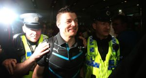 Brian O'Driscoll being escorted through the airport by security. Photograph: Brian Lawless/PA Wire.