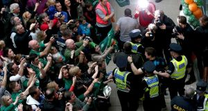 Brian O'Driscoll being escorted through the airport by security and gardai. Photograph: Ryan Byrne/Inpho