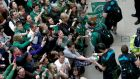 Players sign autographs for fans as they arrive into Dublin Airport this afternoon. Photograph: Ryan Byrne/Inpho