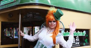 Drag queen Peachy Queen poses from the back of a bus and prepares to march in the St Patrick's Day parade on behalf of all gay, lesbian, bisexual and transgender people for the first time in Sydney, Australia. Photograph:  Don Arnold/Getty Images