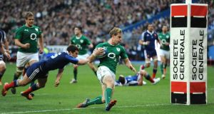 Winger Andrew Trimble crosses to score Ireland's  second try during their Six Nations victory at the Stade de France, Paris, France, on Saturday evening. Photograph: PA