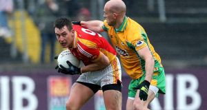 Castlebar's Barry Moran and Damian Burke of Corofin in the Connacht club semi-final. Photograph: Inpho