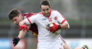 Tyrone's Mark Donnelly hold off Westmeath's Kieran Gavin. Photograph: William Cherry/Inpho/Presseye