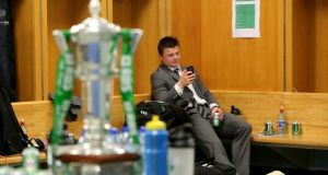 Brian O'Driscoll enjoys a quiet moment in the dressing room after the game. Photograph: Dan Sheridan/Inpho