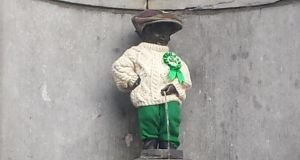 Brussels' Manneken Pis statue was dressed in a traditional Irish costume, comprising a custom-made Aran jumper, Irish tweed trousers and a patchwork tweed cap. Photograph: Suzanne Lynch